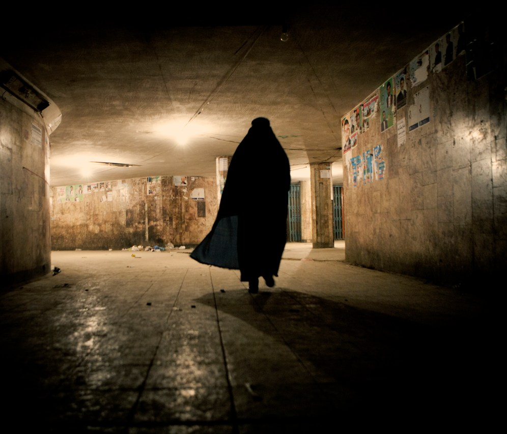 A woman wearing a burqa is silhouetted against the lights illuminating an underpass. In June 2011, President Obama announced his plan to begin the withdrawal of US troops from Afghanistan, but there is currently no end date for the war in the troubled country. Helmand is the largest province in Afghanistan, and the heart of the war against terror. Commanders on the ground have described the situation as the most brutal conflict the British Army has been involved in since the Korean War. Much of the fighting between NATO and Taliban forces is taking place in this province and Helmand is a true Taliban stronghold. The Helmand River flows through the mainly desert region. With these images I am trying to show a softer side to this troubled area of Afghanistan.