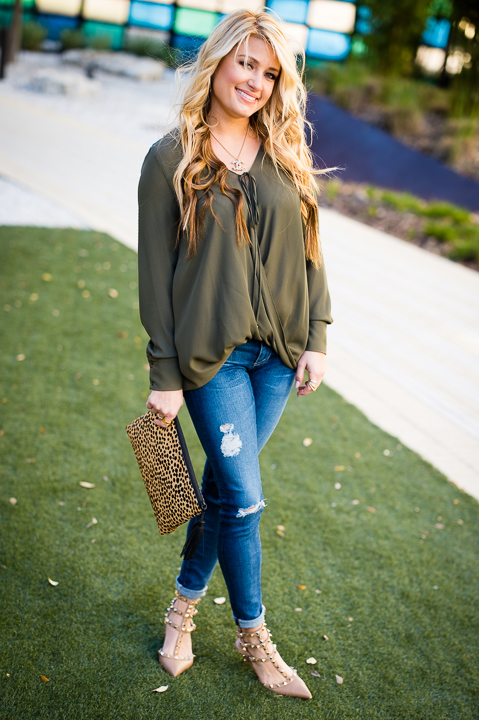 green blouse, valentino, rocketed shoes, ag jeans, cheetah print clutch, loeffler randall