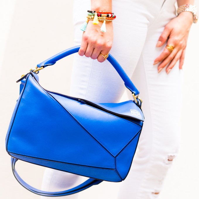 topshop, orange off the shoulder top, white ripped denim, blue handbag, baublebar bracelet, nude joie heels, loewe bag