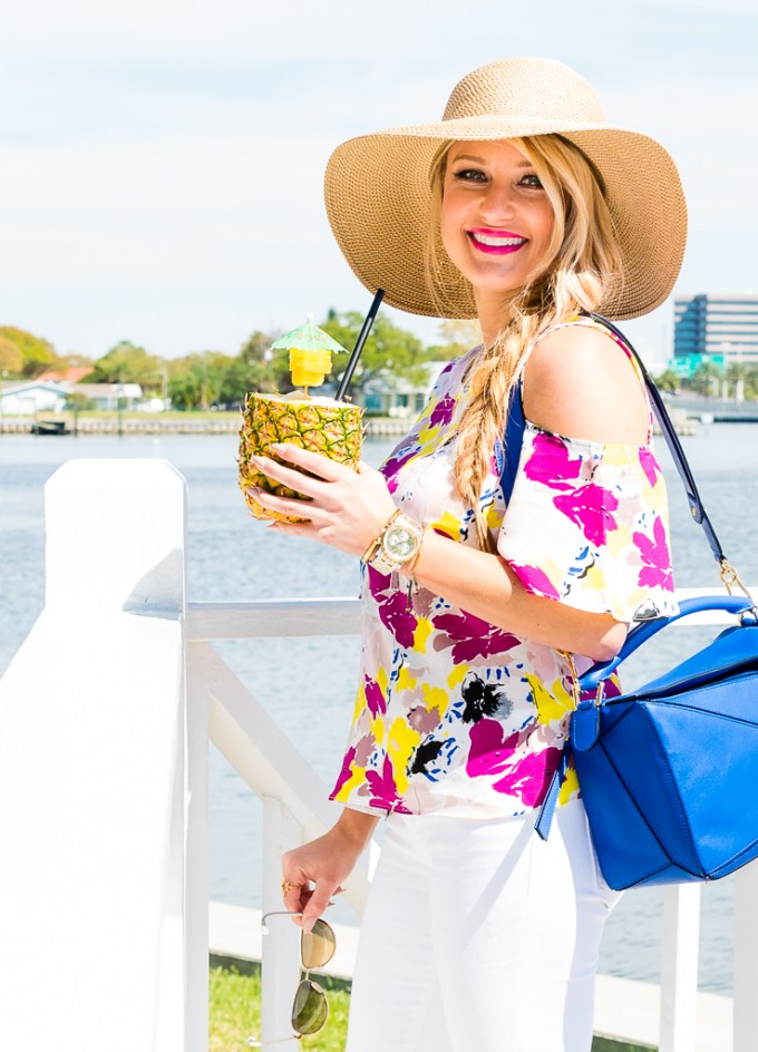 cold shoulder top, aviator sunglasses, floppy hat, gucci sunglasses, floral top, gold hoops, lana jewelry, joie wedges, nude wedges, blue handbag, loewe handbag, puzzle bag