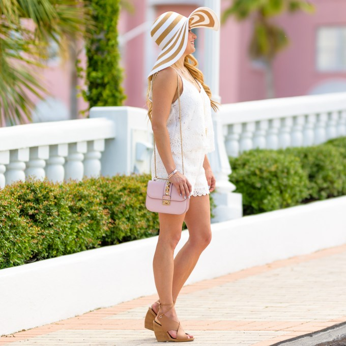 white lace romper, jean jacket, pink handbag, gladiator sandals , rockstud, floppy hat