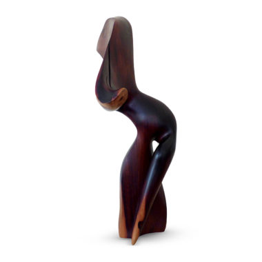 Sculpture titled Lift in dark and light brown Mopane wood. A bird with his beak pointed down wards is raising his tail feathers.