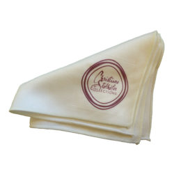 A white polishing cloth folded with Christiane Stolhofer's logo CSC in dark red color.