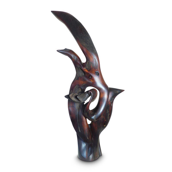 Sculpture titled Your Love Sets Me Free in dark brown Mopane wood. You can see two birds, then lower one is supporting the second bird, that is spreading its wings to take flight.
