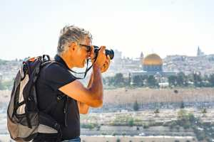 Man photographing tourists in Jerusalem