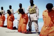 Islamic State militants stand behind what are said to be Ethiopian Christians along a beach in Wilayat Barqa, in this still image from an undated video made available on a social media website