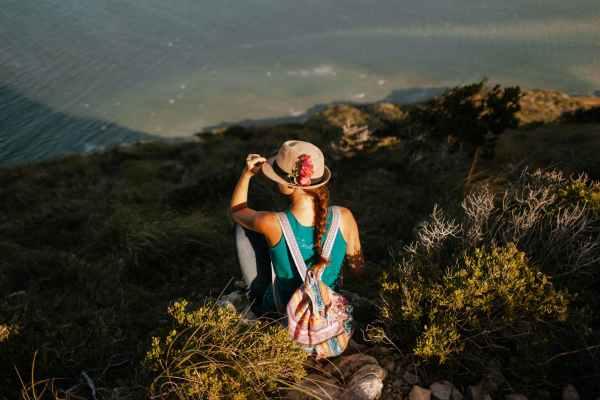 scenery of woman on hillside