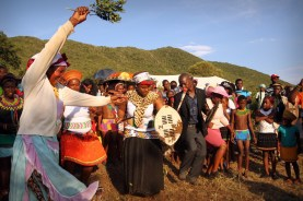 The bride and groom dancing at a traditional Zulu wedding