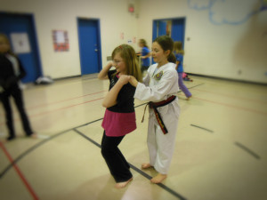 """Here a Girl Guide learns the """"pinky grab"""" to break free."""