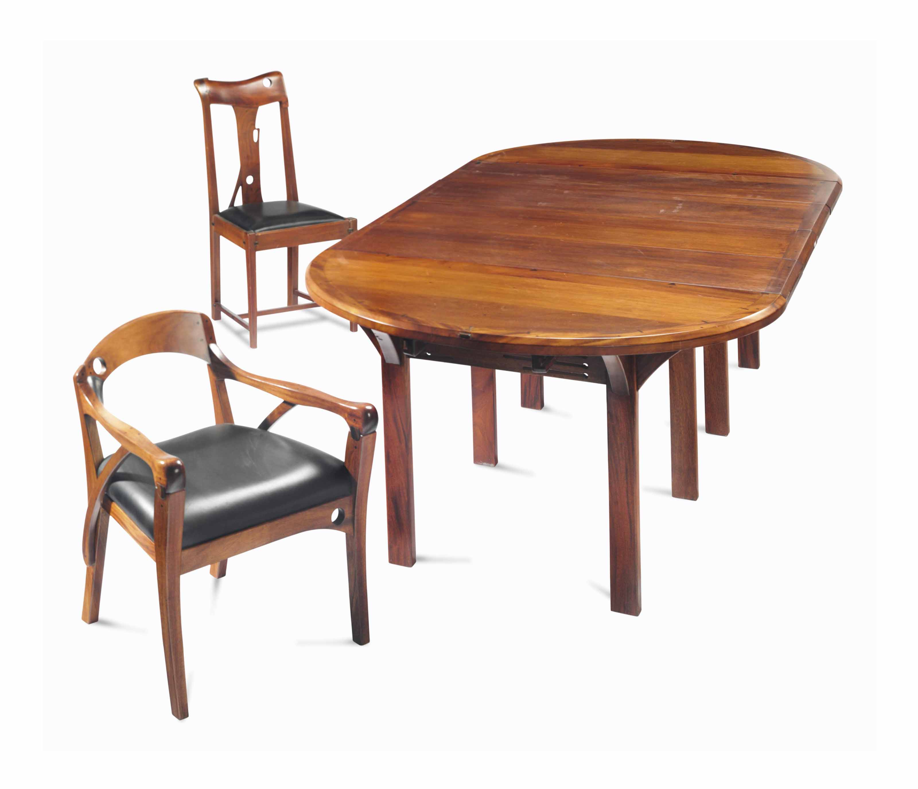 Five Chairs A Mahogany And Walnut Extension Dining Table And Five