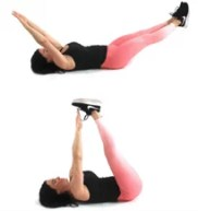 Arm and Leg Lift Flat Stomach Exercise being done by Christina Carlyle