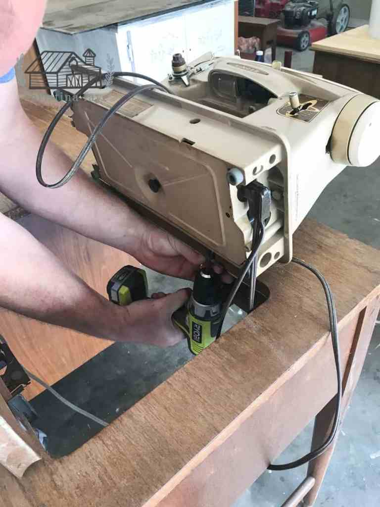 Removing the sewing machine from the sewing table.