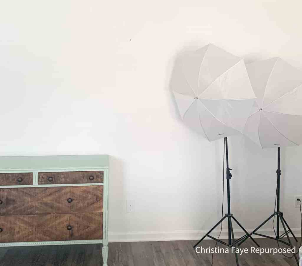 Blank white wall with photography lights.