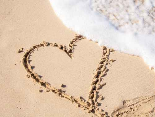 beige sand with heart engrave