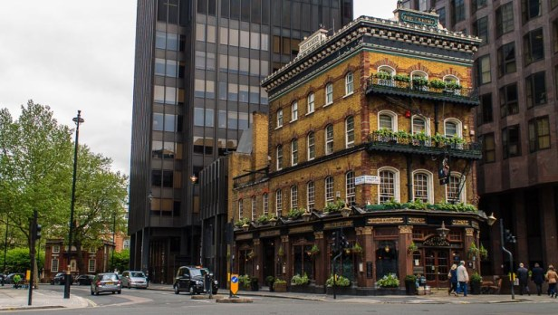The name of the building is the Albert and it is located at the crossing of Victoria Street and Buckingham Gate in London, England