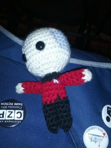 A tiny little Captain Picard, knit out of yarn.