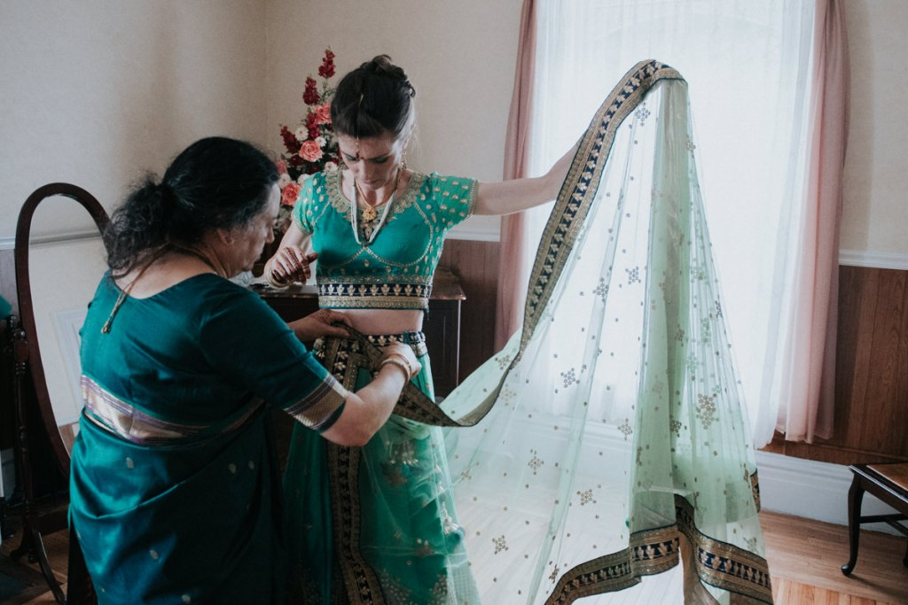 Indian wedding photo of bride getting ready at Dutchess Manor in Beacon NY