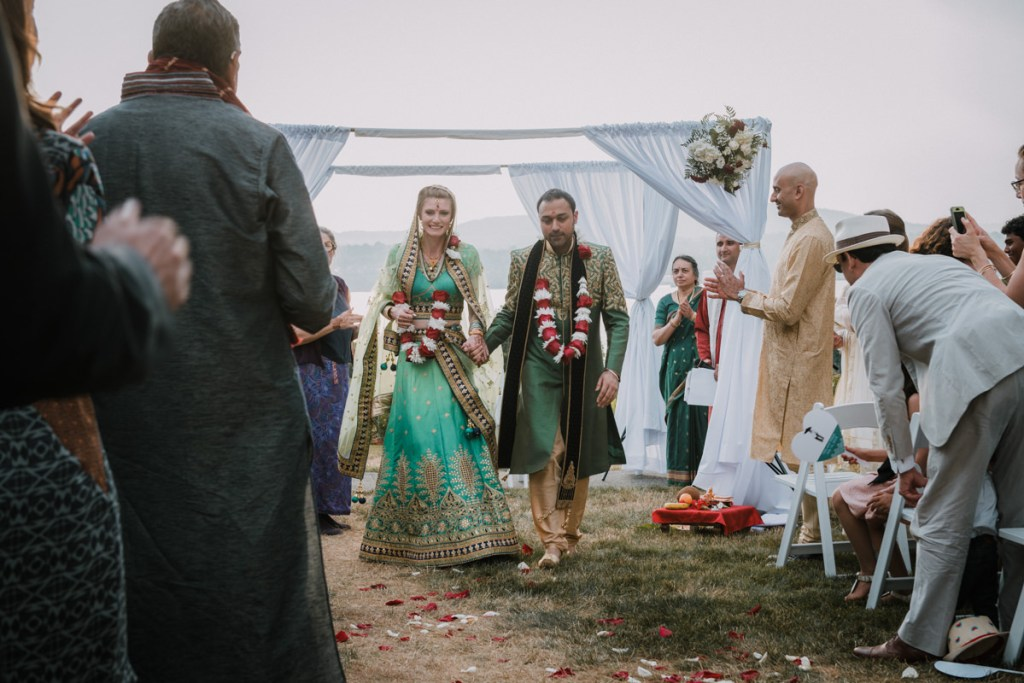 Hudson Valley wedding ceremony photo of bride and groom walking down the aisle at an Indian wedding ceremony