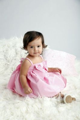 03.My First Party will be memorable pretty in pink spaghetti strap dress with a bow from SM Babies