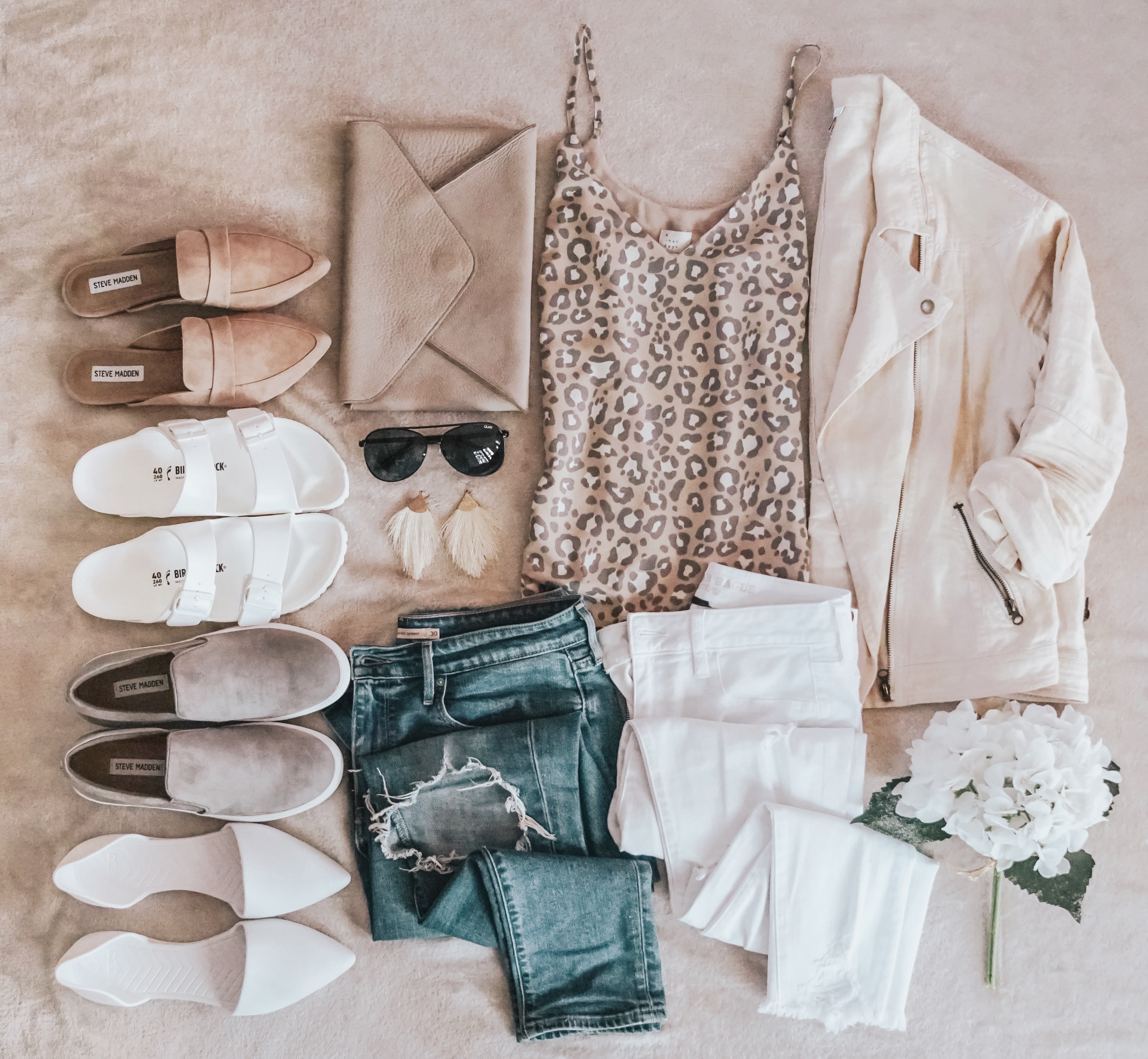 Flatlay featuring leopard print camisole, jeans, moto jacket, loafers, birkenstocks, sunglasses and clutch/how to style