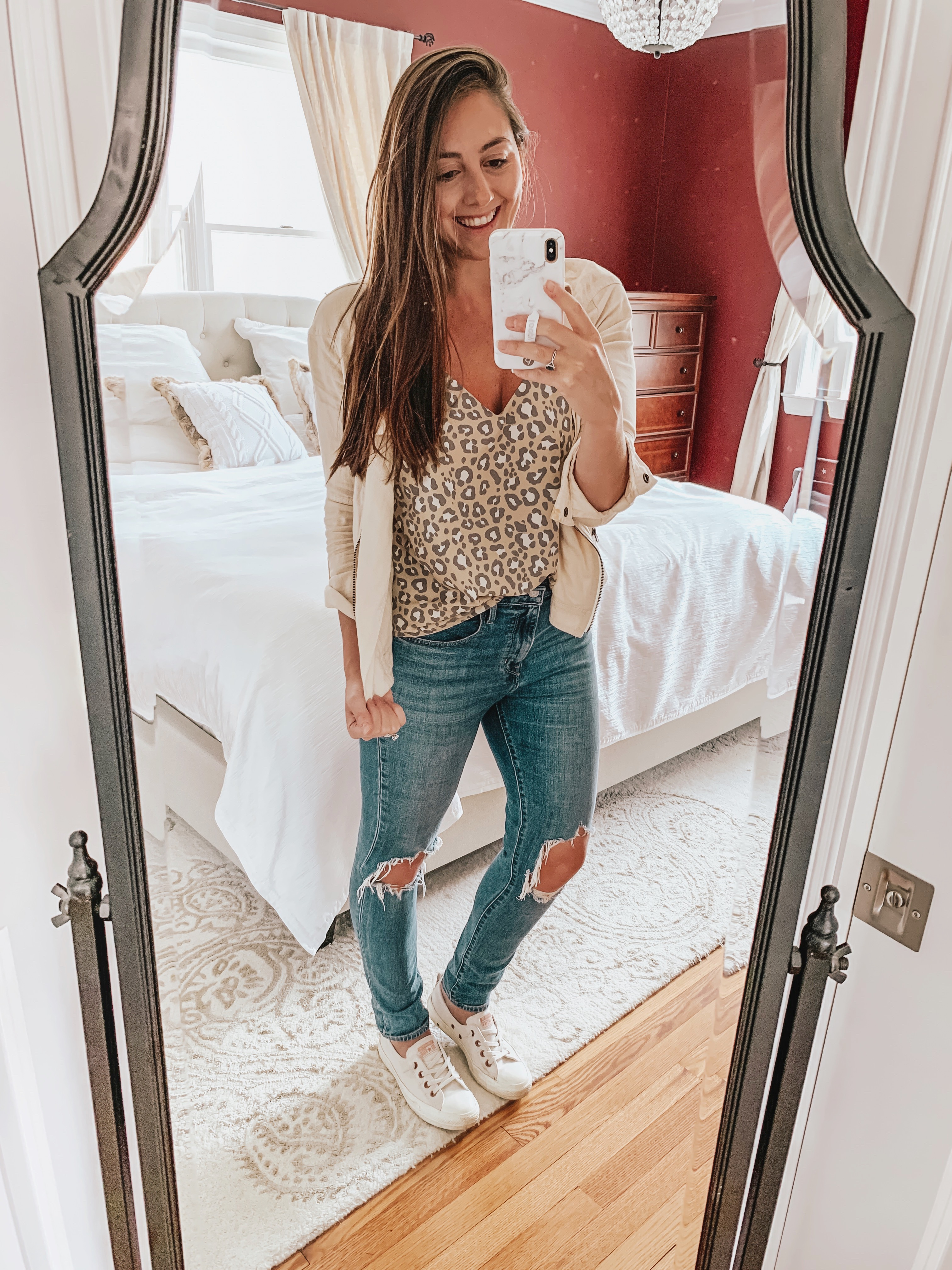 Styling Leopard Print is easy! We are showing you how to style a leopard print top 4 different ways to give you versatilty with basic wardrobe staples!