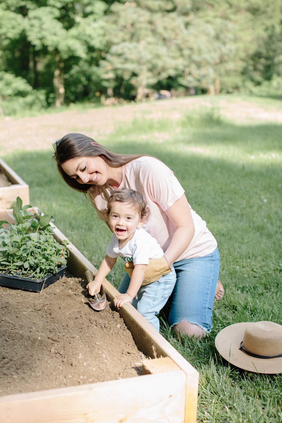 mom and baby planting in QUICK, EASY & INEXPENSIVE DIY RAISED GARDEN BEDS