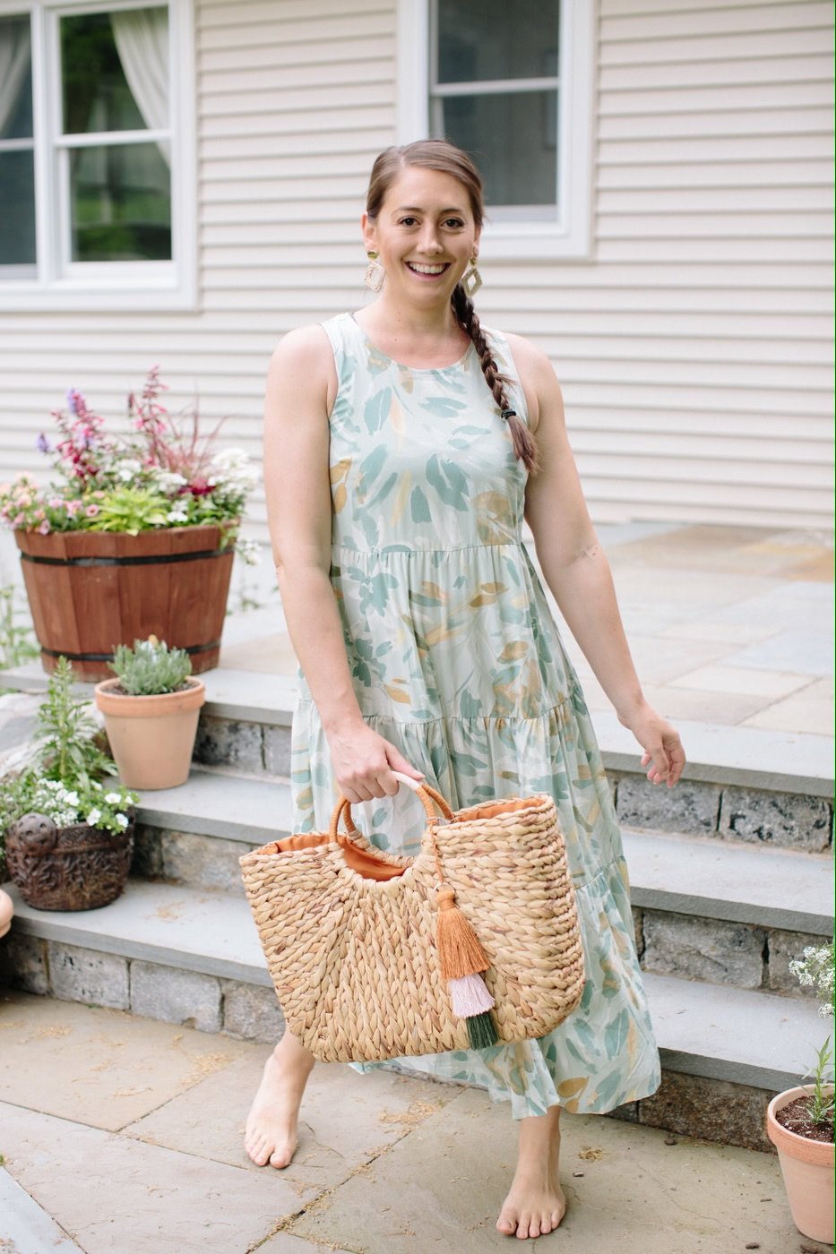 Christine Covino, lifestyle blogger wearing a flowered summer dress
