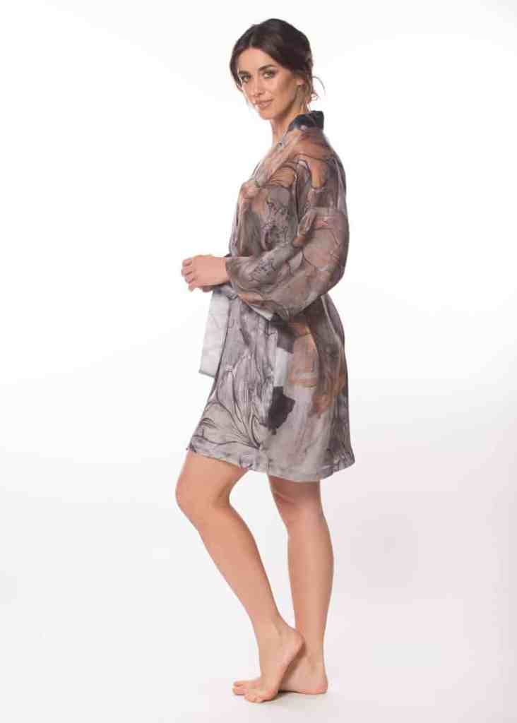 silk short robe with our gold and grey fresco print is worn by a women