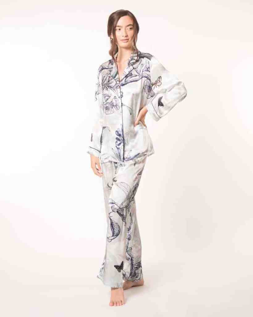 A silk pajama set in out Christine Lingerie floral Botanica print is worn by a women