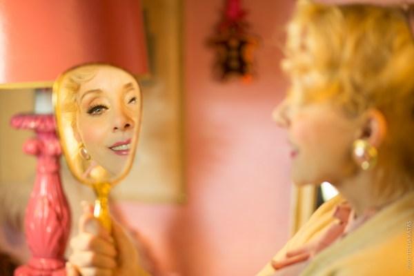 Christine Marie Katas holding a mirror