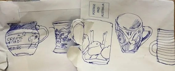 A series of quick biro line drawings of various cups . Drawn on the back of two envelopes