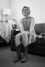 Singer songwriter Christine Rosander putting on boots for the filming of the Been A Long Time music video.