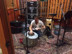 Band member Aaron Sterling getting percussion ready for recording.