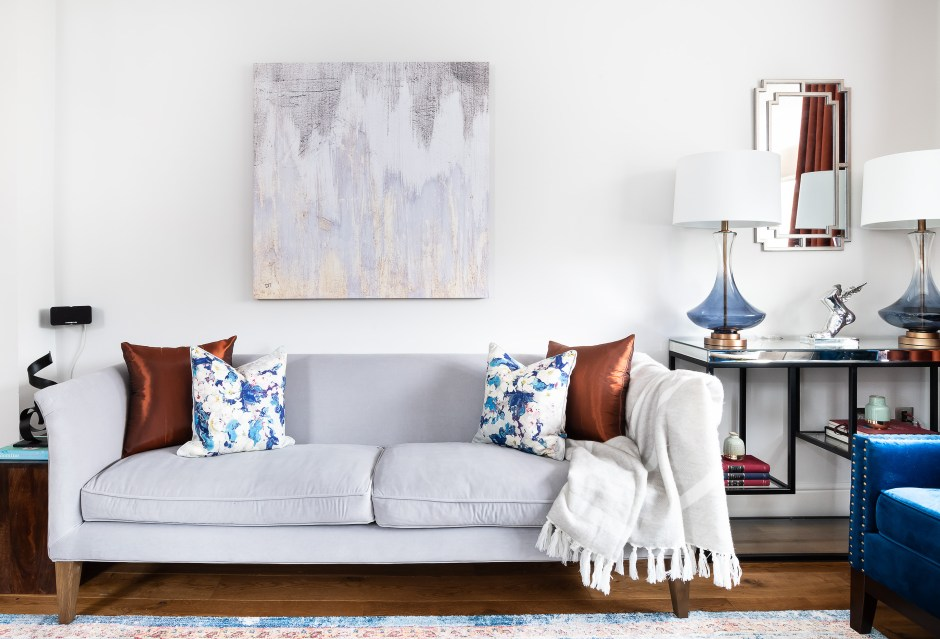Family room _Living Room_blue and copper colour scheme_Blue glass table lamps with white shade_Light grey two seater sofa_Richmond_London_Christine Tse Interiors_London Interior Designer_North London Interior Designer_Copper pillows_Copper cushions_blue and white flower pillow__
