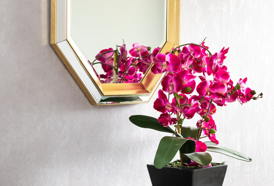 Family room_living room_townhouse_entry_Hallway_brown shoe cabinet console_Gold and copper wallpaper_Brass_Gold Octagonal Mirror_Faux Artificial dark pink orchid in black planter