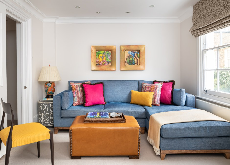 Kensington Townhouse_Family Room_Den_Snug_Yellow and Blue colour scheme_Warm colour scheme_Grandmillennial style_Christopher Farr Fabric_Nicholas Haslam Trim_Modern Blue sectional sofa__brown leather ottoman with naildheads_pink cushion_Turnell and Gigon Fabric_Tse design studio_Christine Tse Interiors_South Kensington_Kensington_American Expat in London neighbourhood_Interior Designer London Kensington_tv room_Yellow raffia cushions