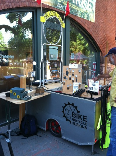 Bike Recycle Designs' bike-pedaled display designed and built with the help of local Burlington artists Aaron Stein