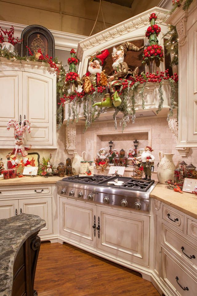 decorating kitchens white wood kitchen table top decorations for christmas celebration all here s such a whimsical way of the we absolutely loved placement elves and santa figures in cabinet