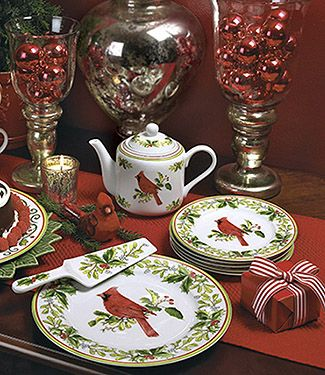Striking cardinals perched on flowing ivy vines and berries create the perfect setting for holiday entertaining. Handpainted porcelain. By j Willfred for Andrea by Sadek