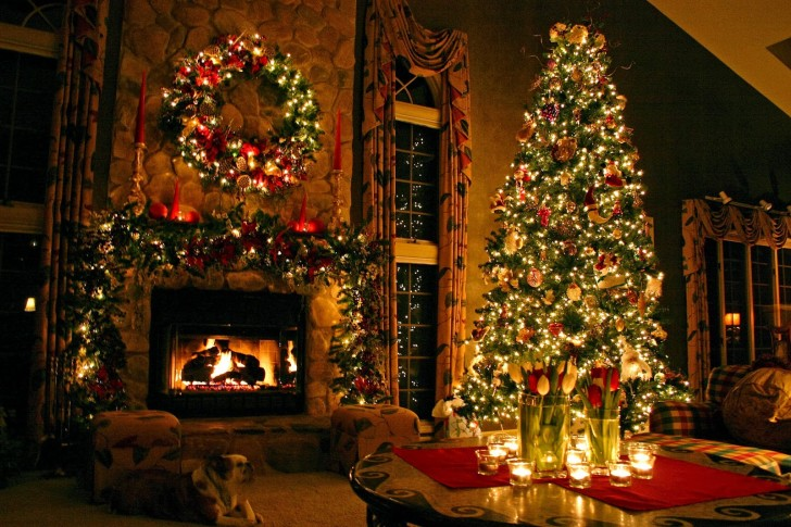 Old-fashioned decorated Christmas tree and fireplace