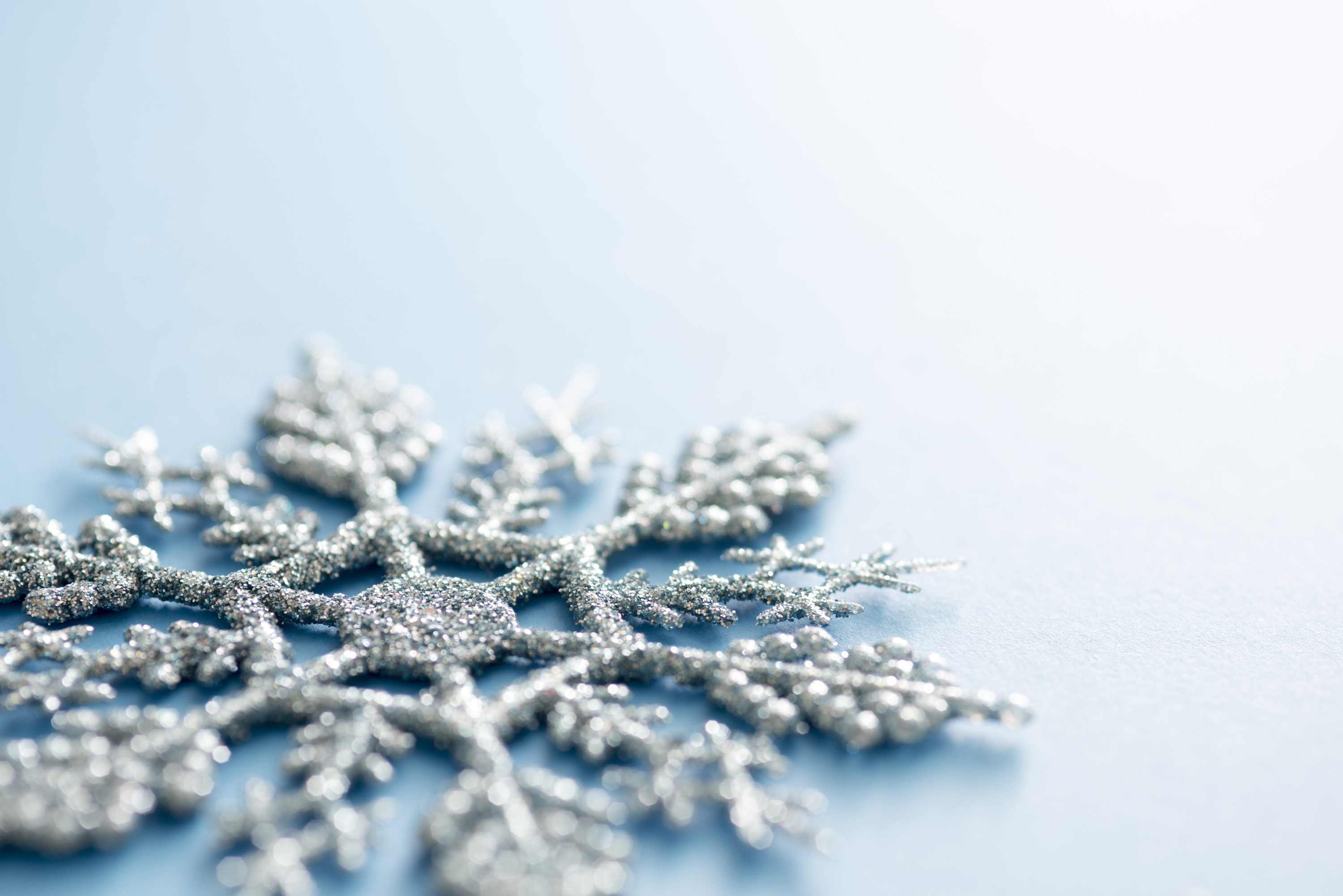 Photo Of Low Angle View Of A Glitter Snowflake Ornament