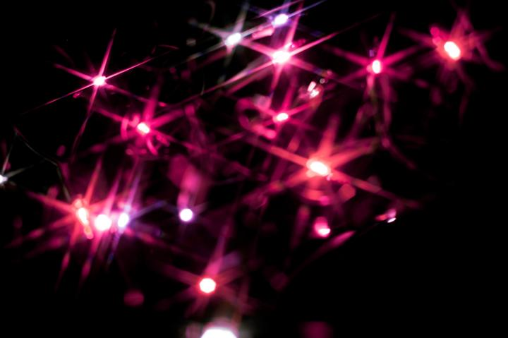Photo Of Christmas Background Of Pink Starburst Lights Free Christmas Images