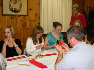 A great crowd ventured out to help trim candles!