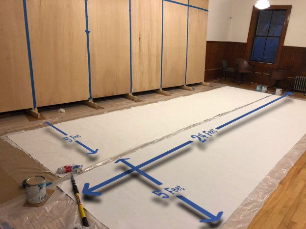 priming the mural canvas