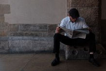 Man reading the newspaper in krakow cloth hall
