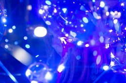 Girl surrounded by lights