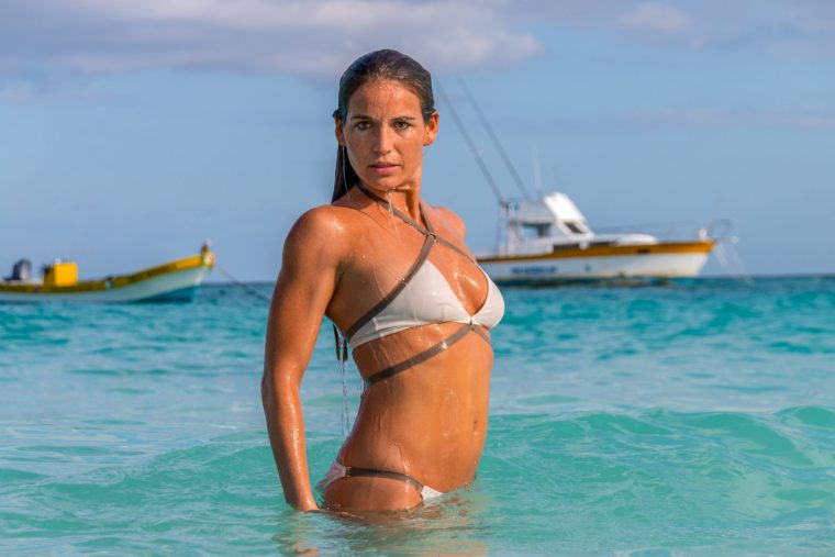 Corky in a white bikini in the ocean in Tulum, Mexico. Photo by Christopher Keelty.