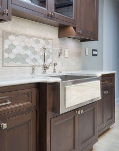 Traditional inset kitchen cabinets with stainless farmhouse sink and Waterstone kitchen faucet.
