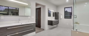 Modern bathroom design with wall hung floating cabinets and led lit mirrors.