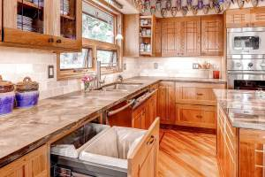 Custom cherry and oak kitchen cabinetry in Denver, CO kitchen remodel with large island and integrated cutting block.